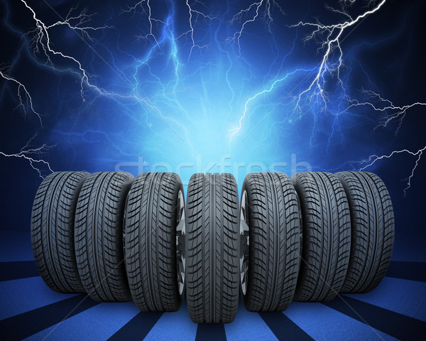 Wedge of new car wheels. Abstract background with lightning Stock photo © cherezoff