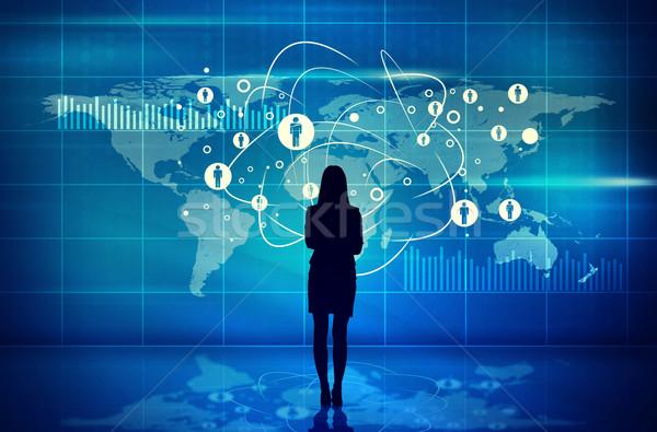 Businesswomans silhouette with virtual screen Stock photo © cherezoff