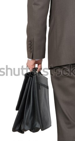 Businessman with case, front view Stock photo © cherezoff