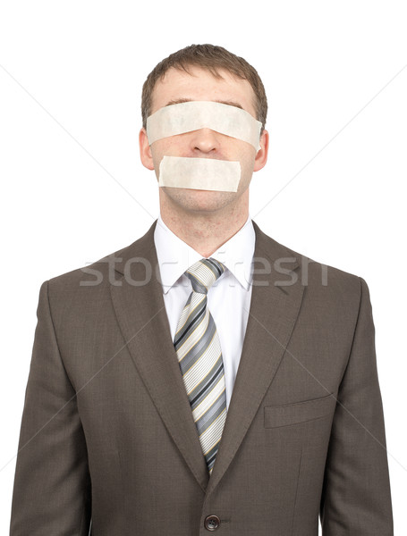 Businessman with tape over his eyes and mouth Stock photo © cherezoff