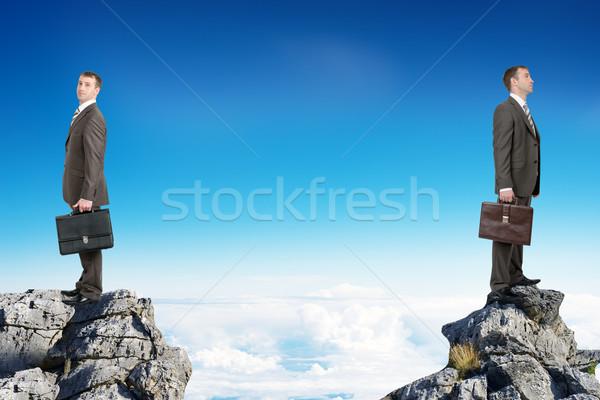 Businessmen standing on peaks  Stock photo © cherezoff