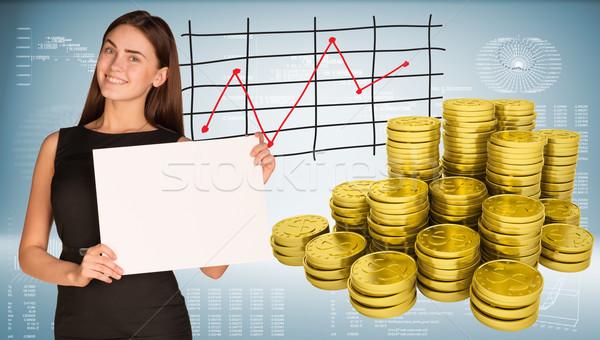 Zakenvrouw houden lege papier gouden munten grafieken Stockfoto © cherezoff