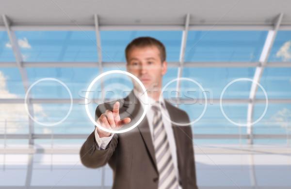 üzletember kisajtolás holografikus képernyő ablak égbolt Stock fotó © cherezoff