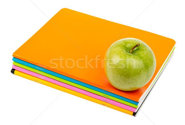 Fresh apple with copybooks Stock photo © cherezoff
