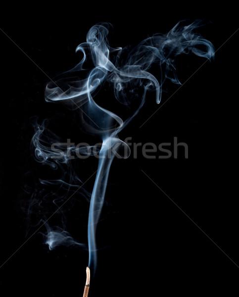 Movement of white smoke on black Stock photo © cherezoff