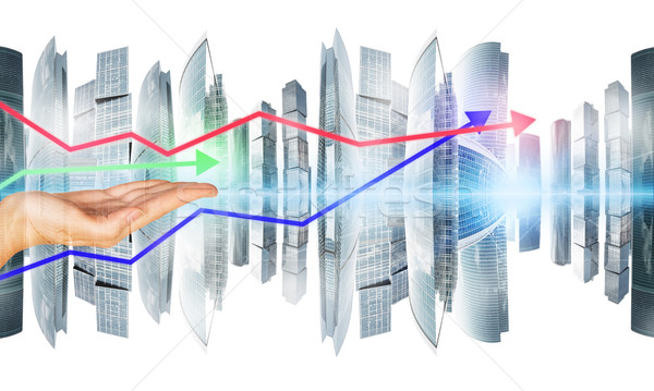 Womans hands with arrows and city Stock photo © cherezoff