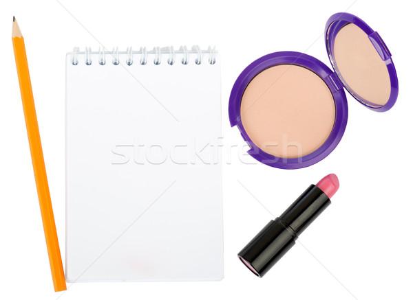 Open copybook with lipstick and powder Stock photo © cherezoff