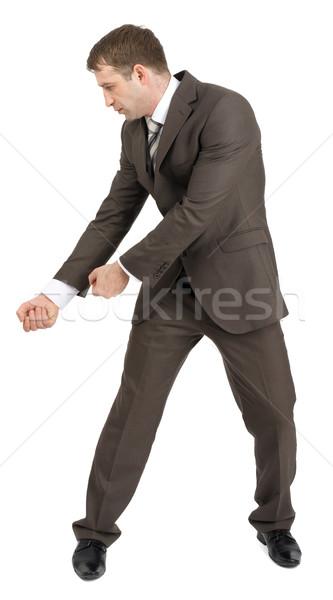 üzletember tart láthatatlan balta izolált fehér Stock fotó © cherezoff