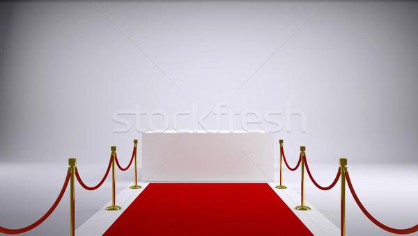 The red carpet and white box. Gray background Stock photo © cherezoff