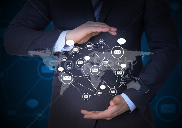 Businessman and network of contacts on hands Stock photo © cherezoff