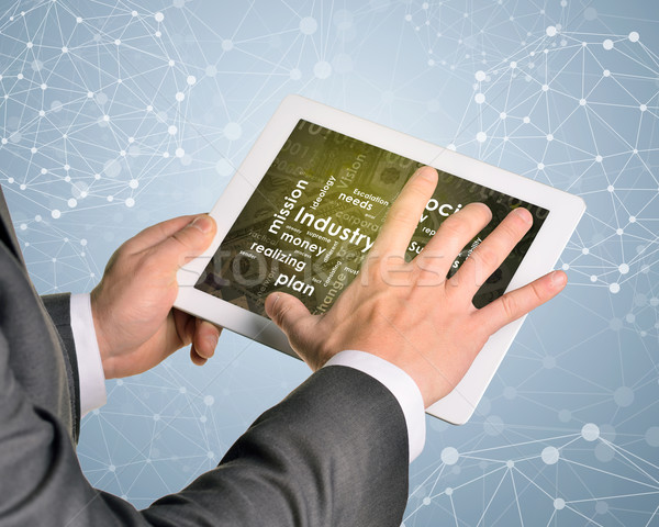 Man hands using tablet pc. Money and business words on touch screen Stock photo © cherezoff