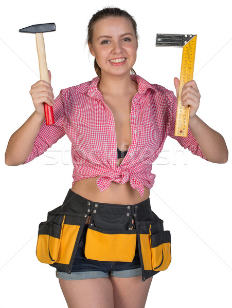 Woman in tool belt holding hammer and angle ruler Stock photo © cherezoff