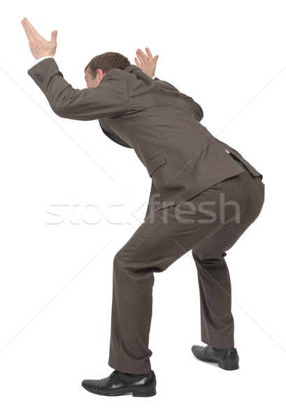 Businessman under heavy empty space, rear view Stock photo © cherezoff