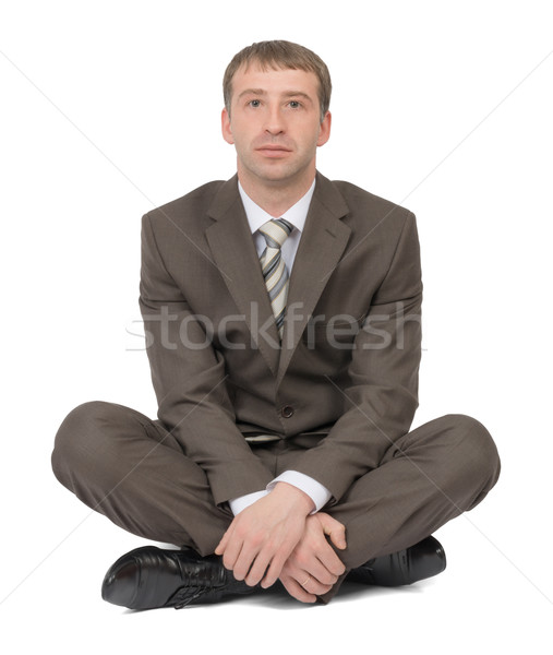 Businessman sitting in lotus posture Stock photo © cherezoff