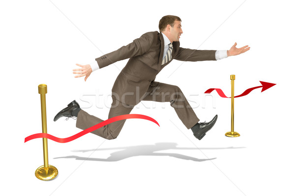 Businessman finishing on white Stock photo © cherezoff