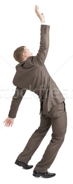 üzletember pózol karok a magasban izolált fehér hátsó nézet Stock fotó © cherezoff