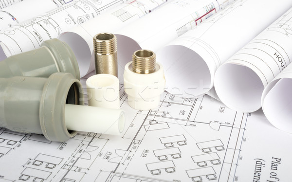 Plumbing fitting on blueprint Stock photo © cherezoff