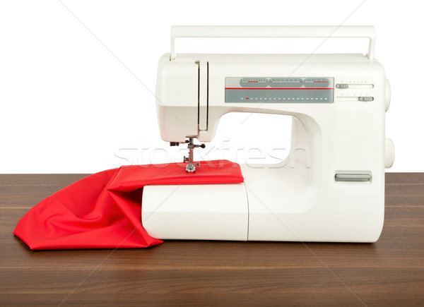 Sewing machine and red fabric isolated on white Stock photo © cherezoff