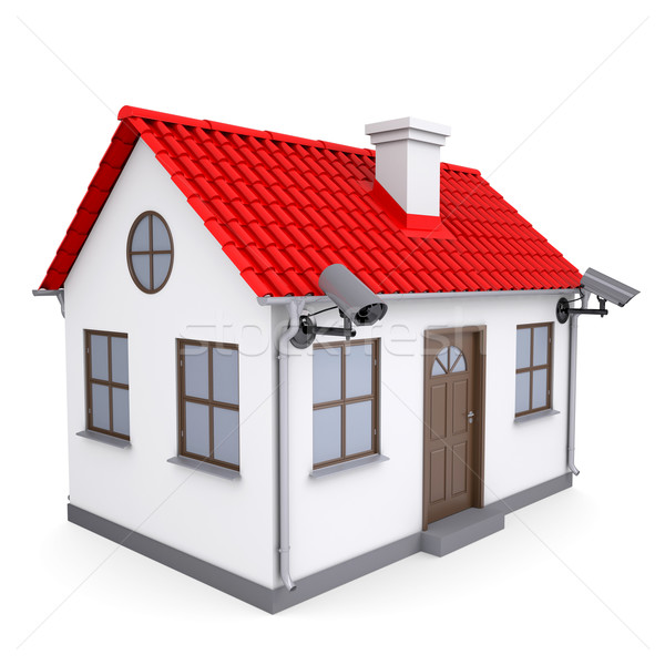 Stock photo: A small house with security cameras