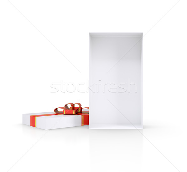 Open gift box. Lid with ribbon and bow located next. Isolated Stock photo © cherezoff