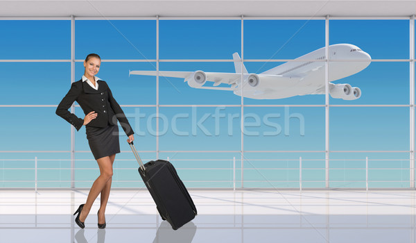 Smiling flight attendant Stock photo © cherezoff