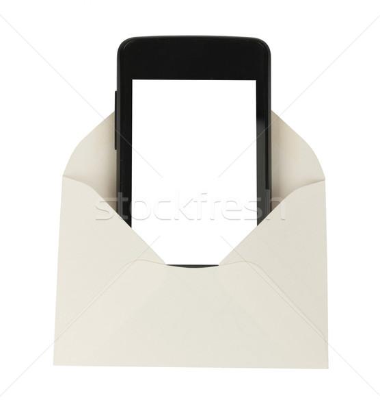 Open white envelope with smartphone Stock photo © cherezoff