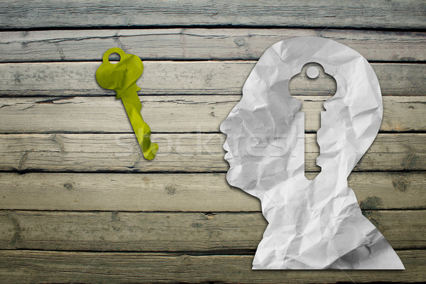 Paper humans head with key sign Stock photo © cherezoff