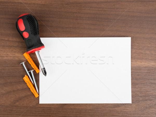 Boş kart tornavida ahşap masa kâğıt kart beyaz Stok fotoğraf © cherezoff