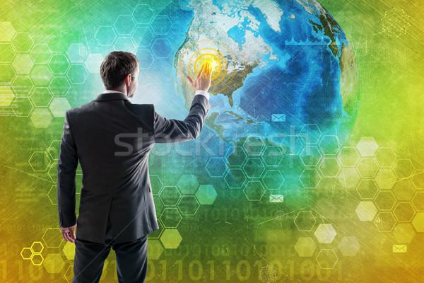 бизнесмен прессы кнопки цифровой костюм земле Сток-фото © cherezoff