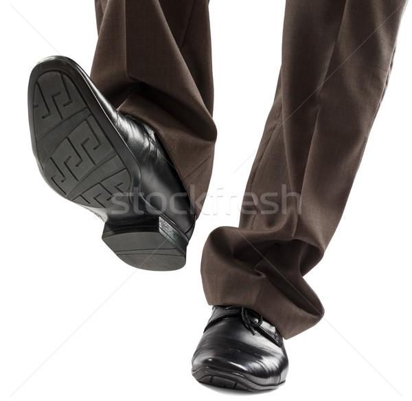 Zapatos piernas empresario precaución paso aislado Foto stock © cherezoff