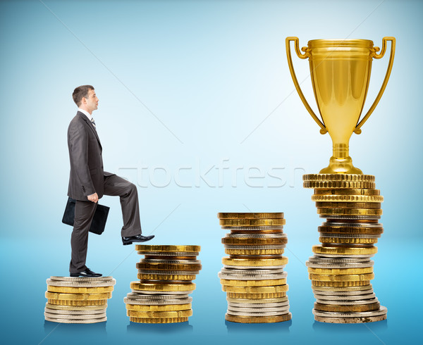 Businessman going up, coins stairs. Stock photo © cherezoff