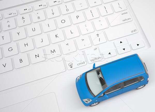 Small car on the keyboard Stock photo © cherezoff
