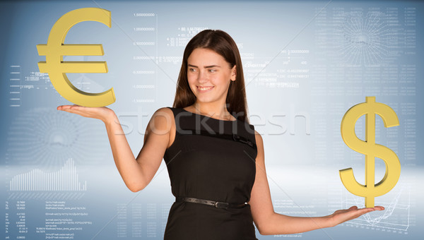 Smiling businesswoman holding dollar and euro signs. Blue gradient background Stock photo © cherezoff