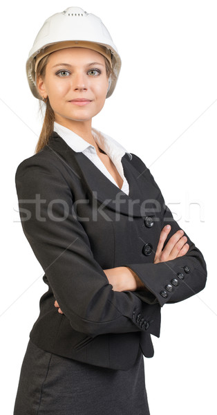 Businesswoman wearing hard hat, her arms crossed on breast Stock photo © cherezoff