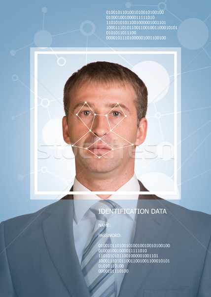 Concept of person identification. Man in suit, looking at camera. Face with lines Stock photo © cherezoff