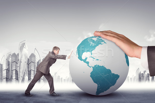 Businessman pushing earth globe stock photo © Kirill ...