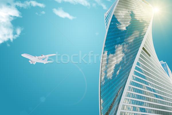 Grattacielo jet sole business nubi città Foto d'archivio © cherezoff