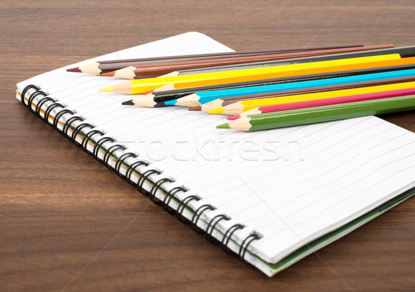 Notebook with crayons Stock photo © cherezoff