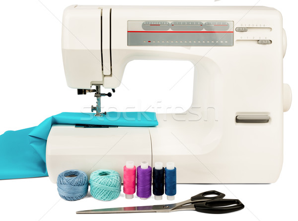 Sewing machine with fabric, threads and scissors Stock photo © cherezoff