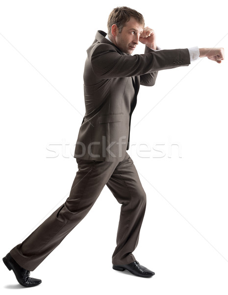 Angry businessman in formal outfit hitting Stock photo © cherezoff