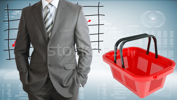Businessman with shopping basket and graphs Stock photo © cherezoff