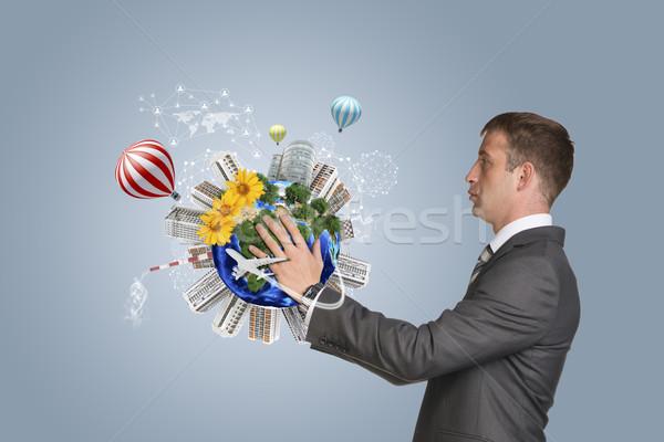ストックフォト: ビジネスマン · ホールド · 地球 · 建物 · スーツ · 要素