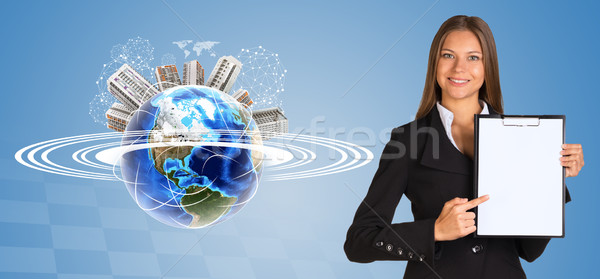 Beautiful businesswoman holding paper holder. Earth with buildings and orbit Stock photo © cherezoff