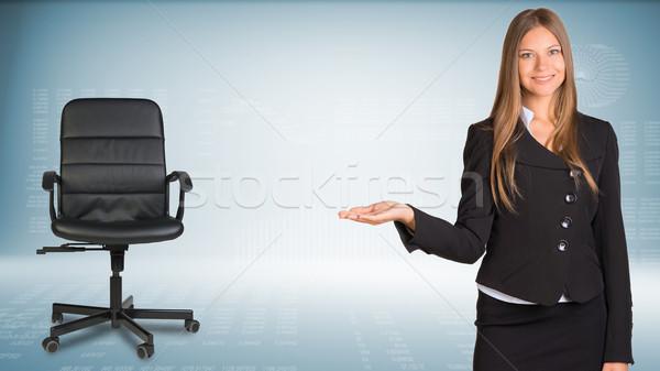 деловая женщина что-то продукт офисные кресла Сток-фото © cherezoff