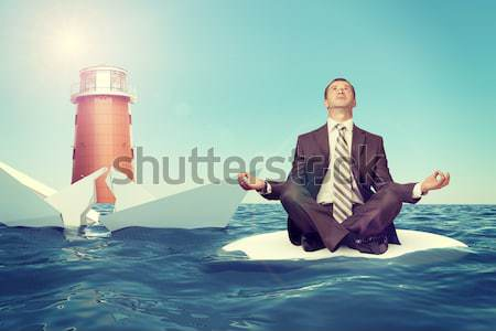 Businessman sitting in lotus position on cloud Stock photo © cherezoff
