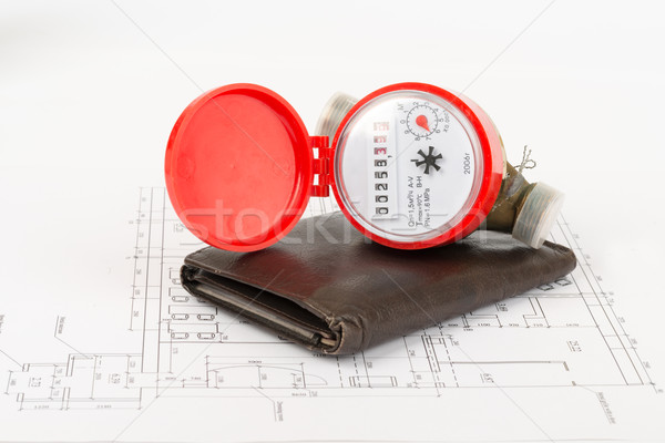Water meter with purse on draft Stock photo © cherezoff