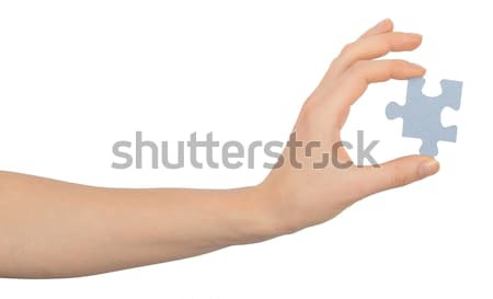 Womans hand holding puzzle piece Stock photo © cherezoff