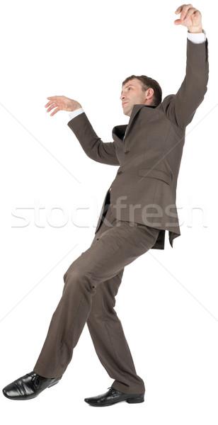 Businessman slipping on banana peel Stock photo © cherezoff