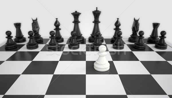 White pawn before the army of black chess pieces Stock photo © cherezoff