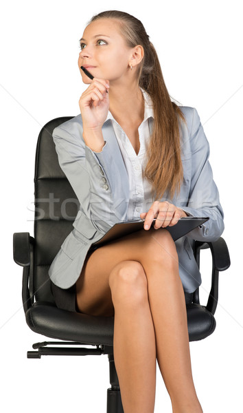 Businesswoman sitting on office chair with clipboard and pen Stock photo © cherezoff